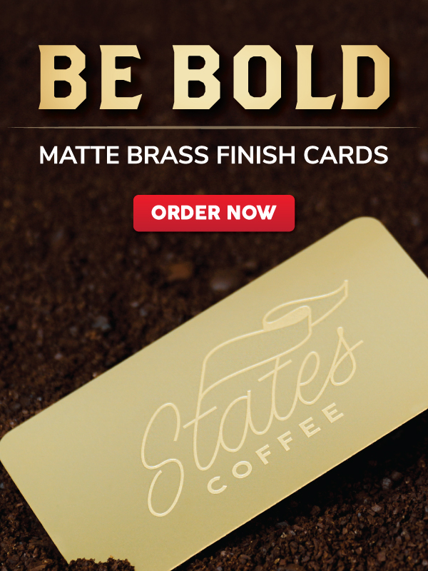 Brass Metal Finish Business Card for Coffee Company sitting in Coffee Beans