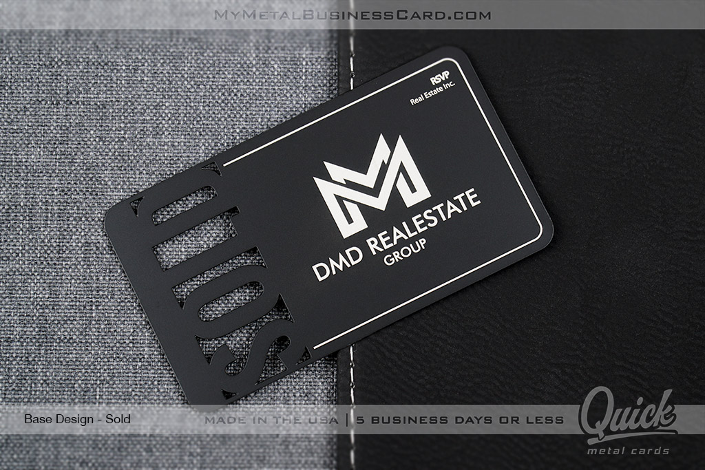 Matte black quick metal business card with silver lettering and the word SOLD cut through