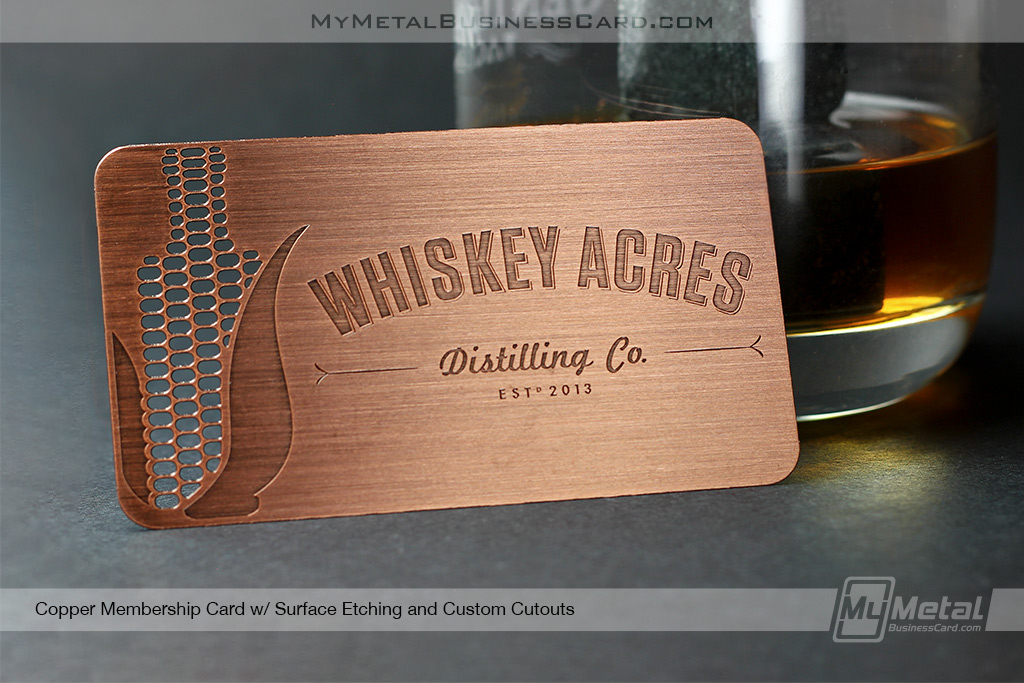copper finish metal business card for a whikey distilery with cut-out corn see-through unique shape