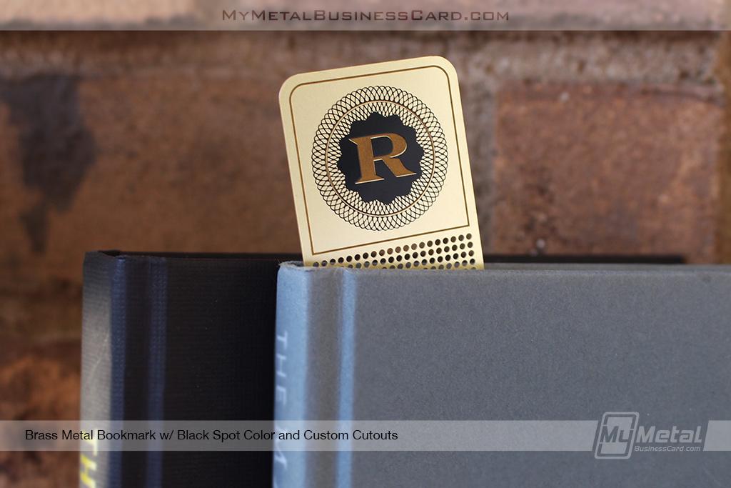 Brass-Finish-Metal-Bookmark-With-Custom-Cutouts-And-Decrorative-R-Logo