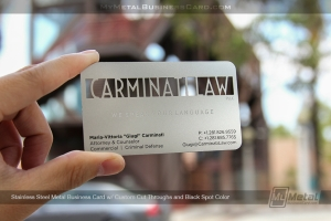 Metal business card for law firm with custom cut-through lettering